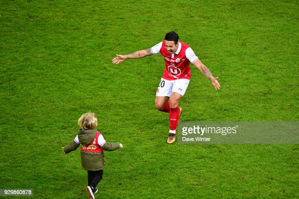 On his 30th birthday Diego Rigonato Rodrigues of Reims celebrates with his children after his side wins the French Ligue 2 match between Reims and...