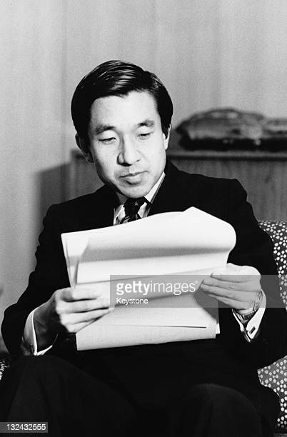 On his 42nd birthday, Crown Prince of Japan, Akihito reads reports on the Okinawa Expo '75 exhibition, at Togu Palace, his residence in Tokyo, 23rd...