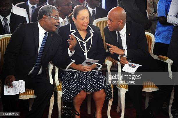 On his first public event newlyinstalled Haitian President Michel Martelly accompanied by his wife Sophia and Haitian Prime Minister JeanMax...