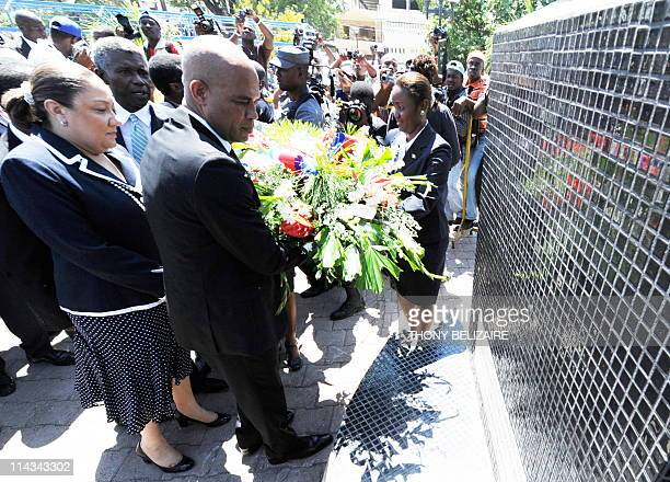 On his first public event newlyinstalled Haitian President Michel Martelly accompanied by his wife Sophia attends a ceremony for Haitian Flag Day in...