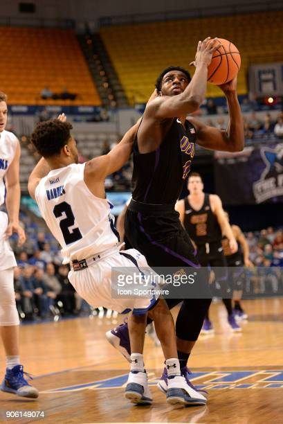 On his way to the basket Northern Iowa Panthers Guard Tywhon Pickford collides with Indiana State Sycamores Guard Jordan Barnes during the Missouri...