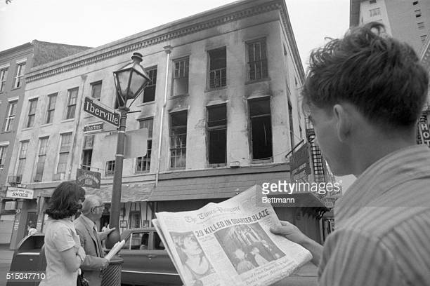 On his way to work 6/25 Chris Benitez glances from the headline in his morning paper to the gutted building in the French Quarter where 29 persons...