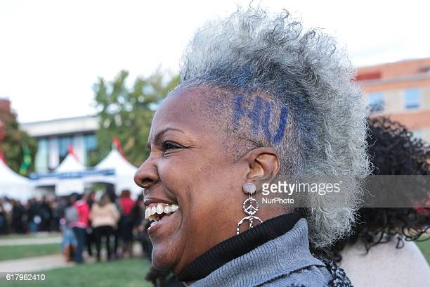 """On Howard University's campus on """"The Yard"""", an alumna shows her school spirit with """"HU"""" cut into her hair to celebrate Howard's..."""