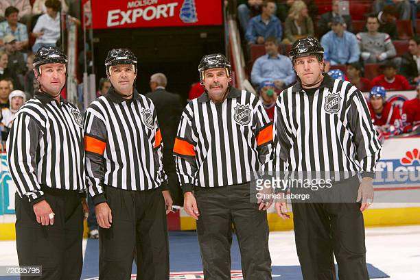 On ice officials Derek Nansen Stephane Auger Bill McCreary and Michel Cormier pose for a photo before the preseason game between the Boston Bruins...