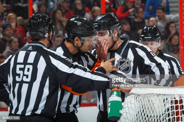 On ice officials Jean Hebert James Tobias and Steve Barton discus after a goal of the Ottawa Senators against the New York Rangers at Canadian Tire...