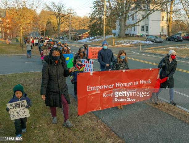 On International Women's Day, parents and supporters marching up Morgan Street to the Arch at Mount Holyoke protesting the planned closure of Gorse...