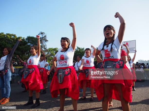 On International Women's Day; Thousands of girls, some wearing red skirts and plastic ovaries, made a demonstration in Lima downtown, asking for...
