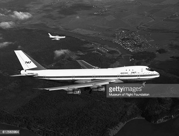 On its first flight on February 9 1969 over the Puget Sound area of Washington State this Boeing 747100 piloted by Jack Waddell is escorted by an F86...