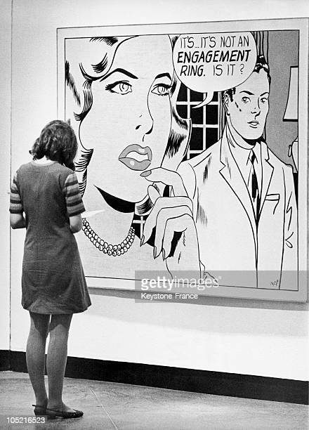 On January 5 At An Exhibition Of Works By Roy Lichtenstein At The Tate Gallery In London This Visitor Contemplates The Painting Called The Engagement...