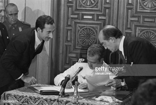 On July 24 1969 in the Palace of Cortes in Madrid Spain Juan Carlos became Prince of Spain seated dressed as an officer sign a document that made him...