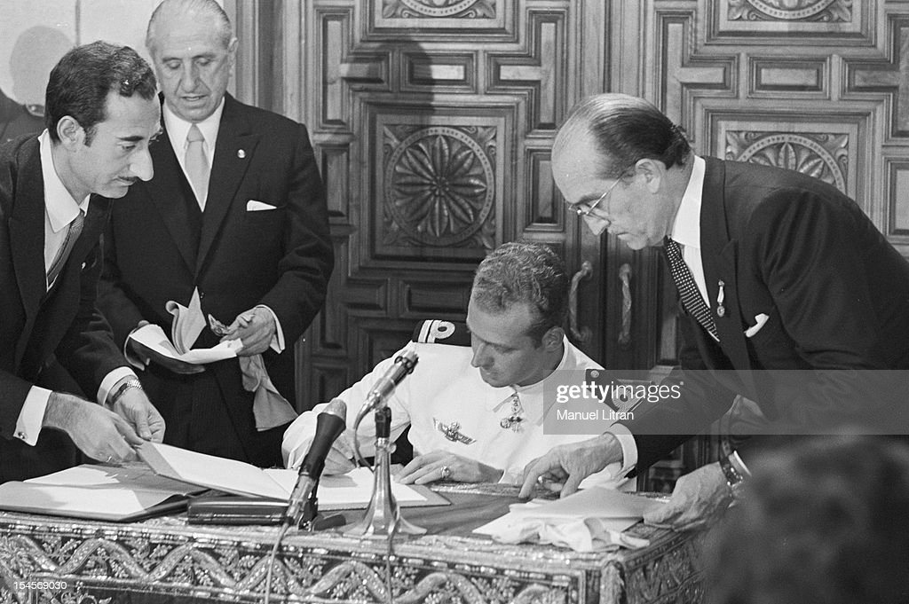 On July 24, 1969 in the Palace of Cortes in Madrid, Spain, Juan Carlos, became Prince of Spain, seated, dressed as an officer, sign a document that made him the official successor of Franco.