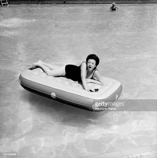 On July 24 1970 in Cannes the French singer REGINE basking in holidays on an air bed in the swimming pool of the hotel casino Palm beach