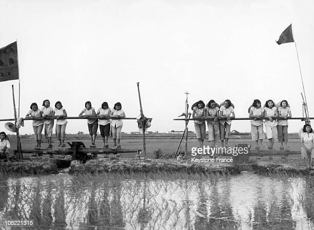 On July 24 During The Great Leap Forward Campaign Chinese Peasant Women Belonging To A Cooperative In The Soochow Region Admire Their Irrigation...