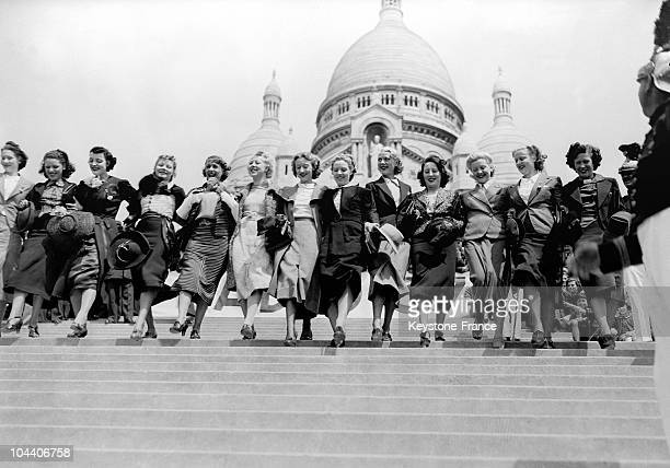 On July 3 on the Butte Montmartre the singer MISTINGUETT training a group of beginners for a competition for walking down the sacreCoeur steps