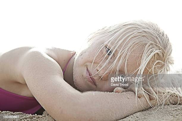 on jumeirah beach, dubai. - lying on front stock pictures, royalty-free photos & images