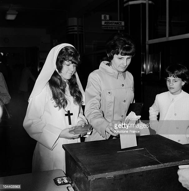 On June 1 at the townhall of Montreuil a girl taking her first communion accompanying her mother voting for the presidential elections Seven...