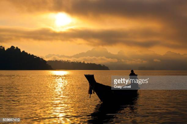 sunset on klong saeng of cheow en lake in khao sok national park - golden hour stock pictures, royalty-free photos & images