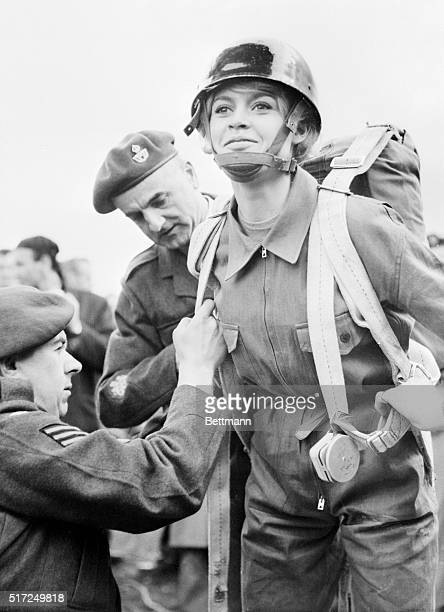 On location for her latest film Babette Goes to War sexy French actress Brigitte Bardot is helped into a parachute at a royal air force base for a...