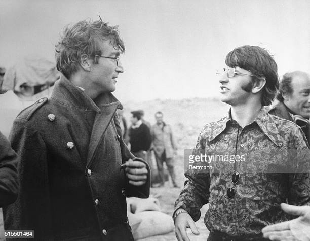 On locationThe Beatles' John Lennon chats with fellow Beatle Ringo Starr during a break on the set of his new movie here Lennon is appearing in How I...
