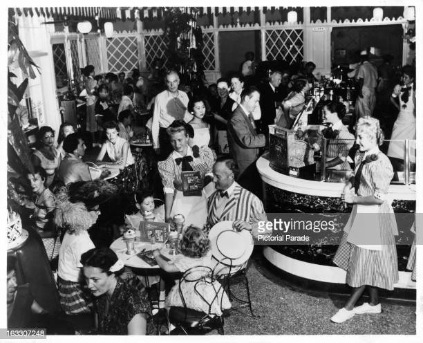 On Main Street at Disneyland, a crowd of happy visitors splurge on various different sweet drinks, The Parlor offers yesteryear favorites such as...