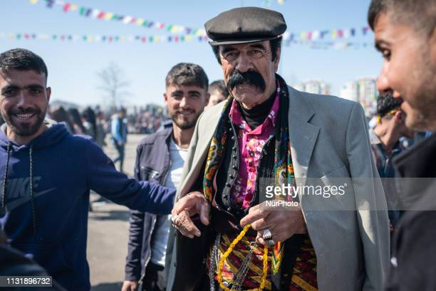 On March 21 a Kurdish man in stylish clothes poses for a photo as residents of Diyarbakir, a Kurdish-majority city in southeast Turkey, celebrate...