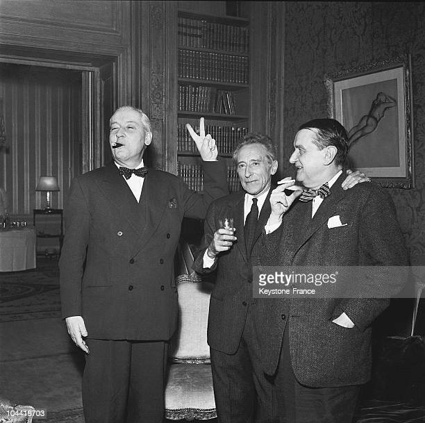 On March 4 after Jean COCTEAU was elected to the Academie Francaise the Paris police prefect Andre Louis DUBOIS pictured with Jean COCTEAU and...