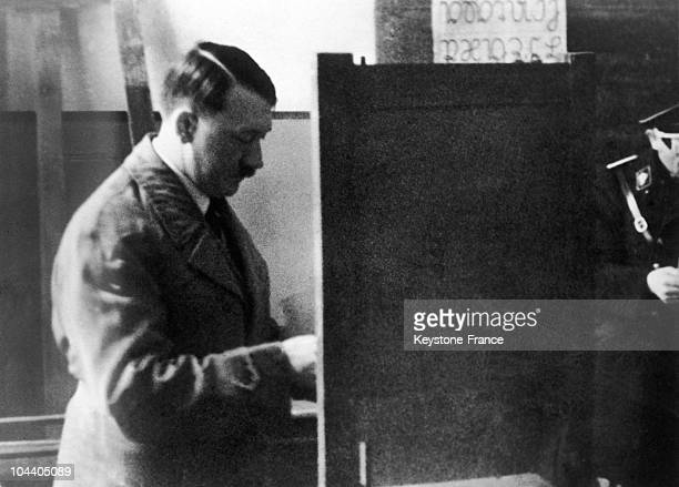 On March 5th in Koenigsberg during the general election in Germany chancellor Adolf Hitler puts his bulletin in the envelope in the polling booth of...