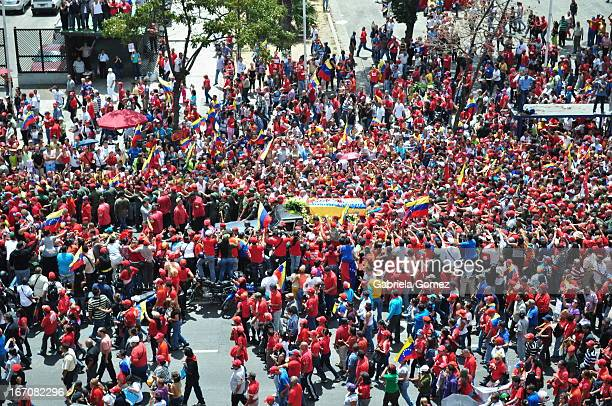 On March 6, 2013 when President Hugo Chavez coffin was paraded through the capital, people were approaching the prosecion, several rings of security...