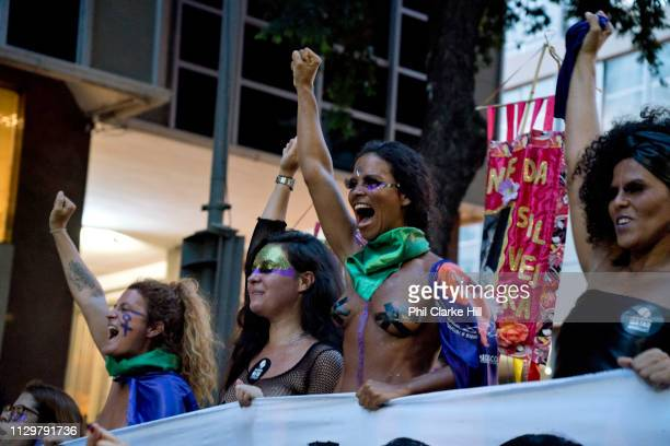 On March 8th 2019 International Women's Day tens of thousands of people gathered and marched through the streets of Rio de Janeiro Brazil Their...