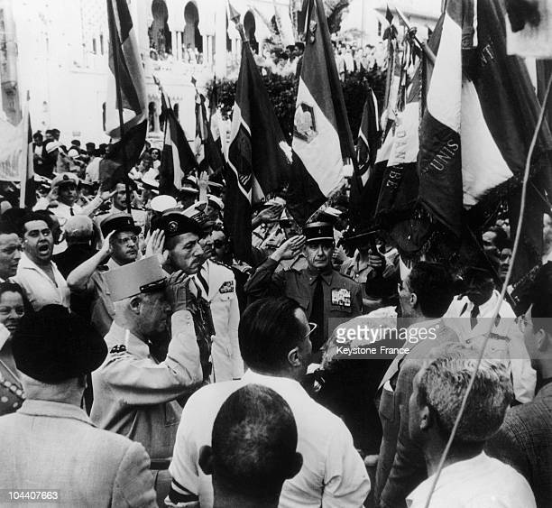 On May 14 after having accepted to head the Committee of Public Safety General Jacques MASSU salutes the tricolor flag with General SALAN before the...
