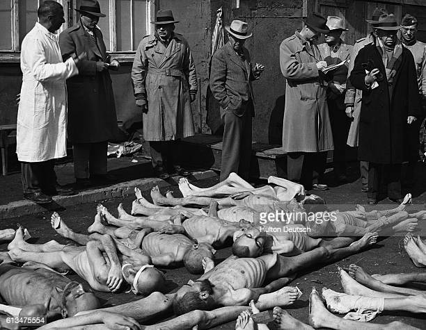 On May 4 1945 a group of American journalists view the emaciated corpses of men who were interned at Dachau concentration camp in southern Germany...