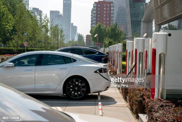 On May15 a Tesla super charging station located in Beijing Huamao center has been officially put into use It is equipped with 20 ground super...