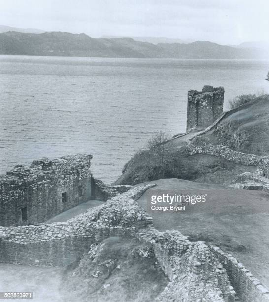 On Monster Watch beside Loch Ness this tourist sits reading amidst the ruins of an old castle and waits hopefully for a sign of Nessie one of the...