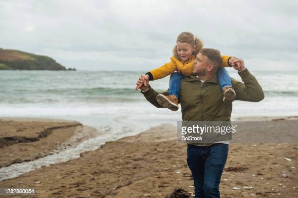 on my dads shoulders - genderblend stock pictures, royalty-free photos & images