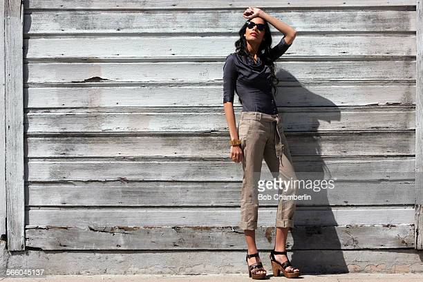 On Nina – Helmut Lang shirt $255 at Helmut Lang Melrose Ave Banana Republic pants $6950 at wwwbananarepubliccom Robert Clergerie shoes $690 at...