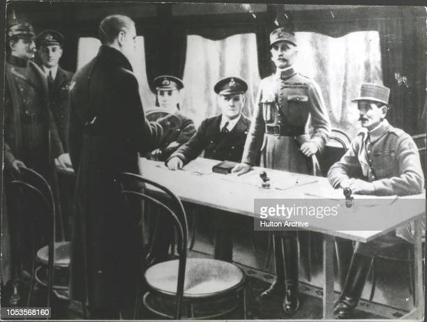 On November 11th 1918 the Armistice was signed in a railway coach at Compiegne Marshal Foch French Commander stands to receive the German...