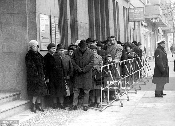 On November 29 Residents Of West Berlin Waiting Near The Wall That Separated East Berlin Obtaining Passports For Serious Reasons To Spend Their...