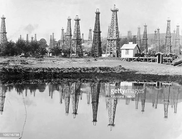 On November 7 The Derricks Of The Refinery Of Santa Barbara Being Refelected In An Oil Slick Formed By Extractions