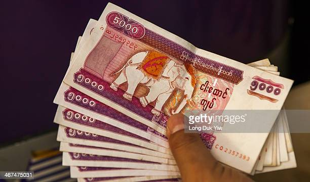 On October 1 5,000 kyat banknotes were issued measuring 150 x 70 mm. Along the top front is written Central Bank of Myanmar in Burmese, and in the...