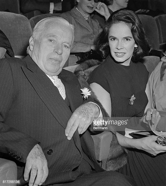 On Other Side of Screen Now Paris Franc Enjoying a busman's holiday old time film comedian Charlie Chaplin and his wife Oona wait for the who to...