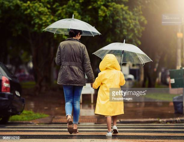 on our way, through the rain we go - winter weather stock photos and pictures