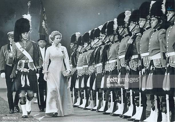 On parade Princess Anne steps out to inspect the guard of the 48th Highlanders of Canada at the Royal Agricultural Winter Fair last night