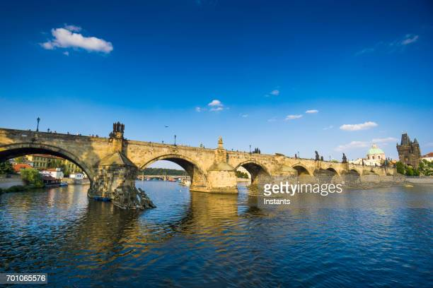 on prague's vltava river, a look at charles bridge and some architecture. - vltava river stock pictures, royalty-free photos & images