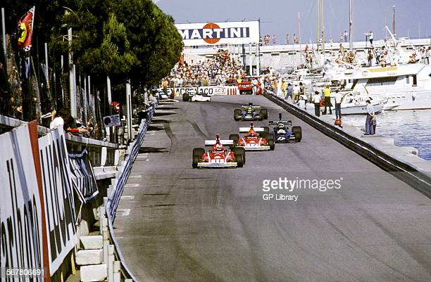On Quai Albert 1erJeanPierre Jarier in ShadowCosworth chasing No11 Clay Regazzoni Ferrari 312 and No12 Niki Lauda Ferrari 312 Monaco GP 26 May 1974