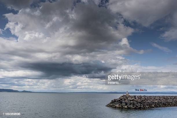 on quebec north coast, in the manicouagan region, portion of the port of sept-îles, meaning seven islands. - river st lawrence stock pictures, royalty-free photos & images