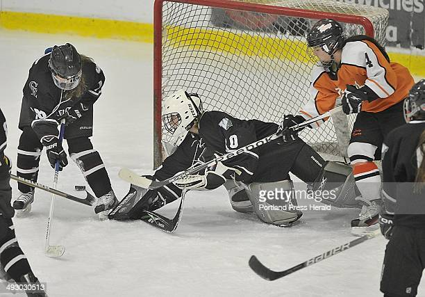 On Saturday January 13 Ce/Waynflete goalie Lily Jordan makes another save in a scramble around the net as Biddeford hosts Cape Elizabeth/Waynflete in...