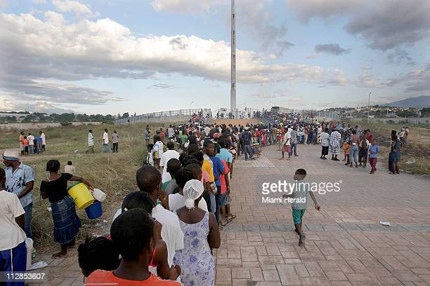 On Saturday January 16 people line up for food as the United Nations' World Food Program distributes supplies to earthquake victims in PortauPrince...