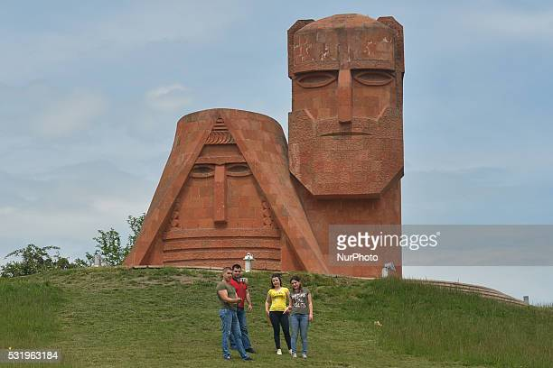 """On Saturday, May 15, 2016: A group of young people take a selfy near """"We Are Our Mountains"""" monument, also known as """"tatik-papik""""..."""