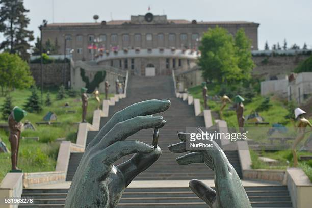 On Saturday, May 15, 2016: A view of the Hands statue, with the view of Alley of Lovers with a staircase decorated with lamps in the shape of a...