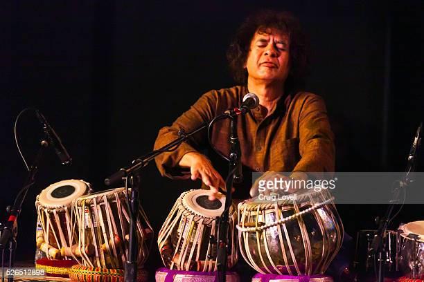 LLOYD on saxophone ZAKIR HUSSAIN on tablas and ERIC HARLAND on drums preform as SANGAM at the MONTEREY JAZZ FESTIVAL